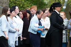 © Licensed to London News Pictures. 24/04/2018. Brownhills, West Midlands, UK. The Funeral of MYLEE BILLINGHAM took place at St James' Church, Church Road, Brownhills, Walsall. Her father, WILLIAM BILINGHAM, of Brownhills, near Walsall, is accused of killing Mylee on January 20 and faces a separate charge of making threats to kill her mother, TRACEY TAUNDRY, on the same day. Pictured, TRACEY TAUNDRY carries one of Mylee's dolls behind the coffin. Photo credit: Dave Warren/LNP