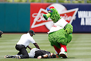 PHILADELPHIA, PA - JUNE 3: Philadelphia Phillies mascot Phillie Phanatic clowns around with Chris Coghlan of the Miami Marlins prior to their game at Citizens Bank Park on June 3, 2012 in Philadelphia, Pennsylvania. The Marlins won 5-1. (Photo by Joe Robbins)