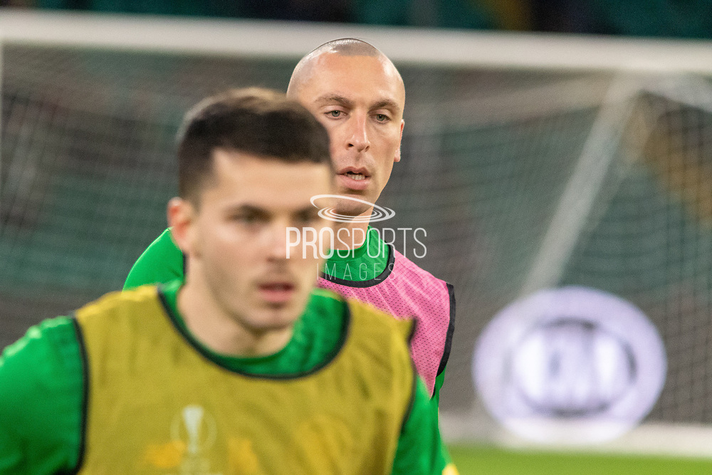 Celtic Captain Scott Brown (C) (#8) keeps an eye on the warm up ahead of the Europa League match between Celtic and Rennes at Celtic Park, Glasgow, Scotland on 28 November 2019.