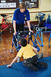 Pupil with cerebral palsy preparing to use equipment