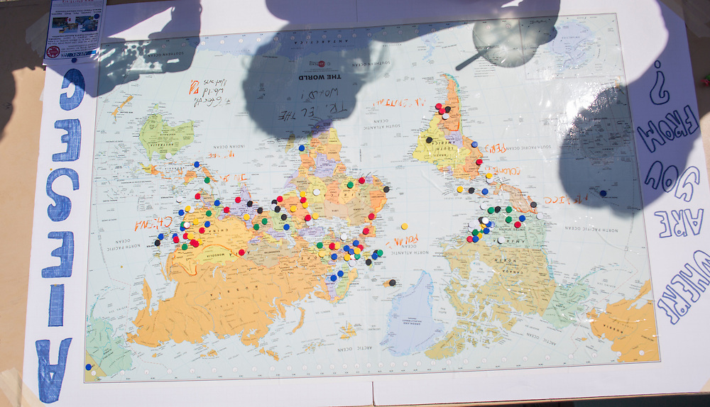 A map at the International Street Fair allows passersby to mark where they are from.