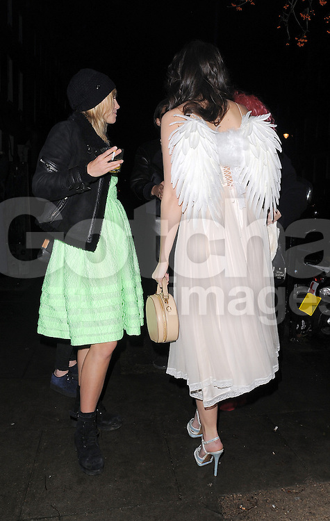 Daisy Lowe wearing her wings and Sukki Waterhouse at the Love Magazine Christmas party in London. UK. 17/12/2013<br />