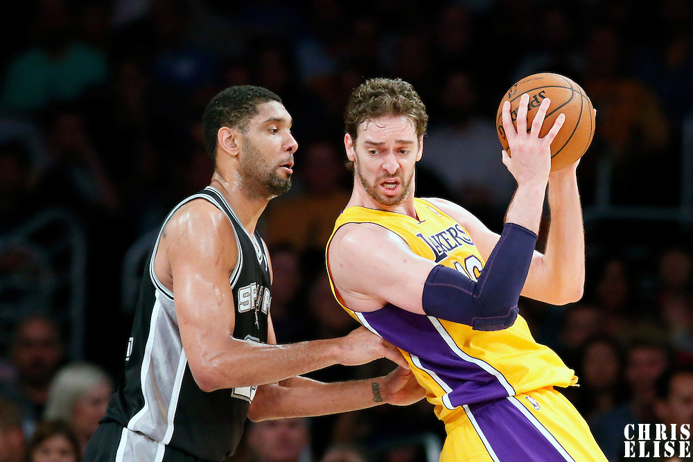 19 March 2014: Los Angeles Lakers center Pau Gasol (16) posts up San Antonio Spurs forward Tim Duncan (21) during the San Antonio Spurs 125-109 victory over the Los Angeles Lakers at the Staples Center, Los Angeles, California, USA.