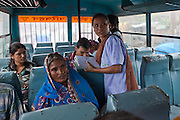 Manav Seva Sansthan, MSS, staff engage with migrants crossing the border into India from Nepal by bus. They work along side the Indian border security agency, SSB, to give people information and help on human trafficking.