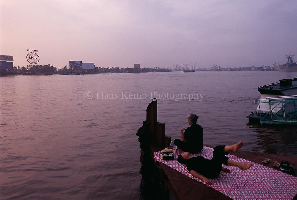 Morning exercises along the Saigon River