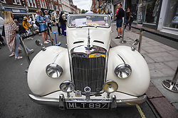 © Licensed to London News Pictures. 17/06/2018. LONDON, UK. A 1951 Alvis TA 21 at the 6th Annual Classic and Supercar Pageant held at St John's Wood High Street.  Traditionally taking place on Fathers' Day, the show brings together an eclectic mix of exotic and popular vehicles attracting visitors young and old and raises funds for the local charity, The St John's Hospice.  Photo credit: Stephen Chung/LNP