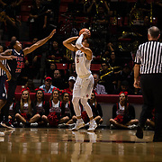 17 January 2018: San Diego State Aztecs guard Trey Kell (3) attempts a step back jumper over Fresno State Bulldogs guard Ray Bowles Jr. (22) in the first half. San Diego State leads Fresno State 40-36 at halftime at Viejas Arena. <br /> More game action at www.sdsuaztecphotos.com