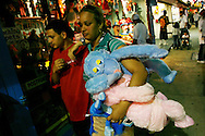 A woman holds stuffed toys won at the Astroland Amusement Park in New York, May 27, 2007. The Coney Island amusement closes for goods at the end of the 2007 season ahead of a major redevelopment that will raze much of the lovably seedy boardwalk area. REUTERS/Keith Bedford (UNITED STATES)