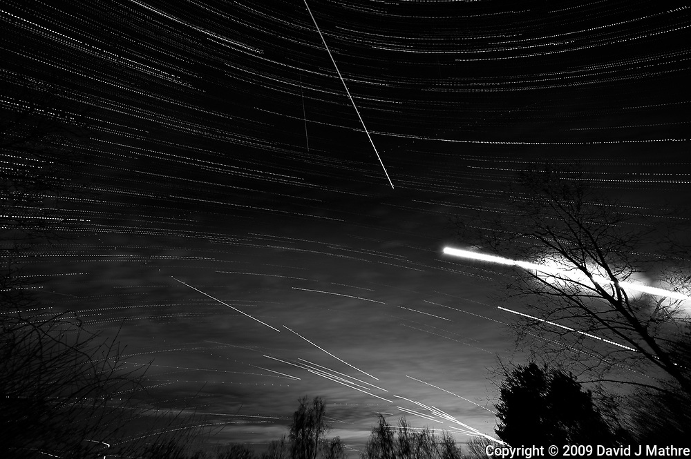 Star, Moon, and Jet Trails + Clouds. Backyard Night Sky Over New Jersey Looking South. Composite of 129 images taken with a Nikon D3 camera and 14-24 mm f/2.8 lens (ISO 200, 15 mm, f/2.8, 25 sec)