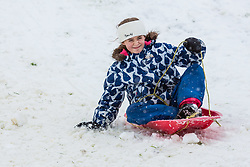 © Licensed to London News Pictures 10/12/2017, Cirencester, UK. People sledging in the Roman Amphitheatre in Cirecenster and enjoying the heavy snowfall . Photo Credit : Stephen Shepherd/LNP