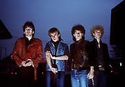 Photo of U2 Bono, Larry Mullen, Adam Clayton, The Edge at gas station in Atlanta - USA Tour 1981