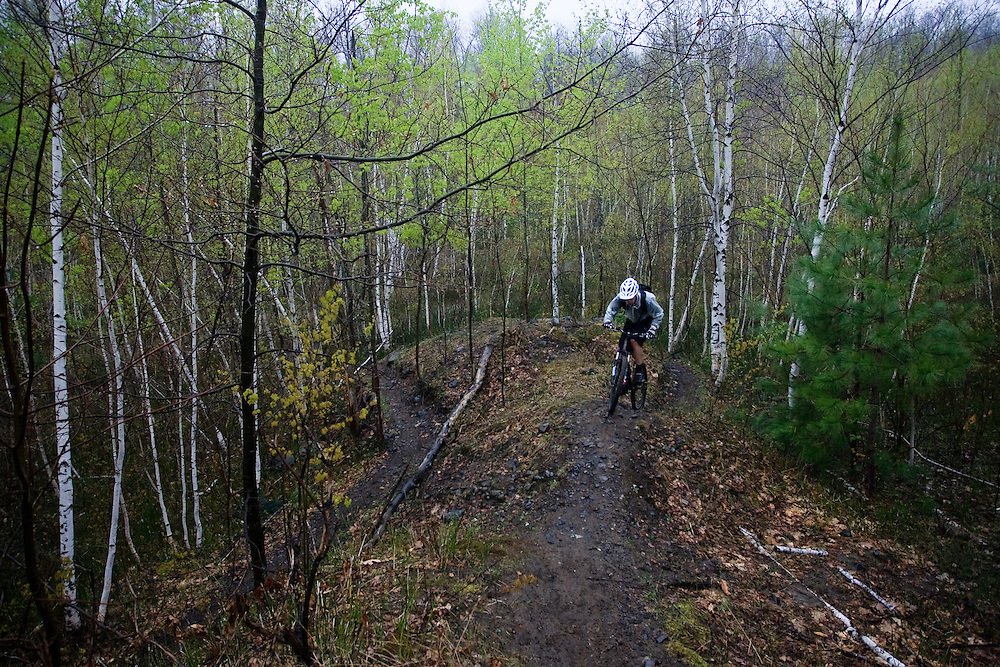 Spring mountain biking on a rainy day in Sommet Trinite, St-Bruno, Quebec, Canada.
