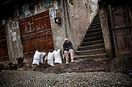 A WFP beneficiary waits to transport his rations outside a food distribution centre, on 24 February, 2011, in Madyan, Swat Valley, Pakistan.