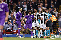Juan Cuadrado of Juventus and Sergio Ramos of Real Madrid argue during the UEFA Champions League Final match between Real Madrid and Juventus at the National Stadium of Wales, Cardiff, Wales on 3 June 2017. Photo by Giuseppe Maffia.<br /> <br /> Giuseppe Maffia/UK Sports Pics Ltd/Alterphotos