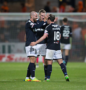 August 9th 2017, Dens Park, Dundee, Scotland; Scottish League Cup Second Round; Dundee versus Dundee United; Scorer of the Dundee's winning goal Paul McGowan is congratulated at full time by James Vincent and Kevin Holt