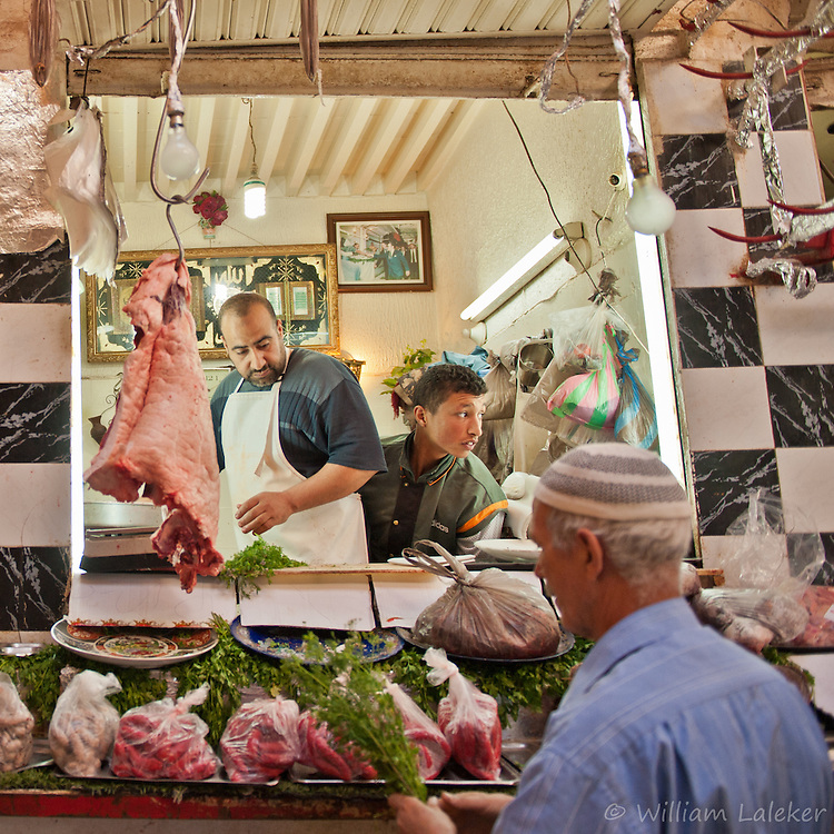 Butcher in Souk with Camel meat