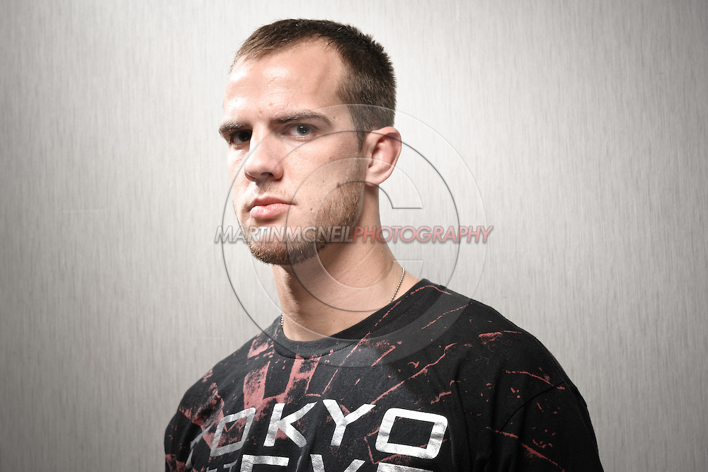 A portrait of mixed martial arts athlete Cole Miller