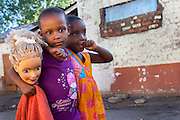Two little girls and a doll&rsquo;s head are photographed at Durban Deep&rsquo;s old &ldquo;Skomplaas&rdquo; hostel on the outskirts of Johannesburg, South Africa.<br /> While the gold mine was still operating, the hostel housed hundreds of goldminers. Today a large number of families live in the crumbling buildings. Sanitary facilities are very poor and rats abound.