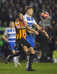 Reading's Daniel Williams is closed down by Reading's Pavel Pogrebnyak as he attempts to clear the ball - Photo mandatory by-line: Dougie Allward/JMP - Mobile: 07966 386802 - 16/03/2015 - SPORT - Football - Reading - Madejski Stadium - Reading v Bradford City - FA Cup - Quarter Final - Replay