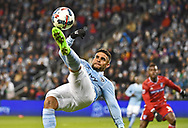 Kansas City, KS, USA; Sporting KC forward Dominic Dwyer #14 goes up for a bicycle kick against FC Dallas during the first half at Children's Mercy Park.