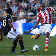 Stoke City F.C. Midfielder STEVEN N'ZONZI (15) attempts to pass the ball in the first half a MLS regular season international friendly match against the Philadelphia Union Tuesday, July. 30, 2013 at PPL Park in Chester PA.