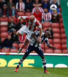 Stoke City's Stephen Ireland battles with West Bromwich Albion's Youssuf Mulumbu- Photo mandatory by-line: Matt Bunn/JMP - Tel: Mobile: 07966 386802 19/10/2013 - SPORT - FOOTBALL - Britannia Stadium - Stoke-On-Trent - Stoke City V West Brom - Barclays Premier League