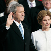 Presidential Inauguration 2005- GEORGE W. BUSH.Washington, DC.01/20/2005.West Front - US Capitol.President Bush is sworn in with First Lady Laura by his side...Photo by Khue Bui..