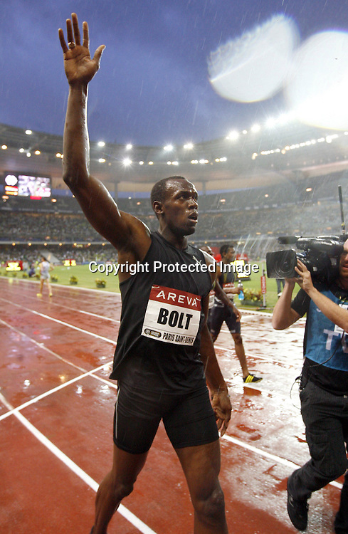 Usain Bolt after winning the 100 metre event, at the IAAF Golden League Track and Field meeting on 17 July 2009 in Paris, France. Photo: Panoramic/PHOTOSPORT *** Local Caption ***
