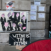 Posters and a tent tied onto the cathedral. Day three of the occupation - and the first Monday. The Occupy London Stock Exchange movement was formed in London in solidarity with the US based Occupy Wall Street. The movements are a respons and in anger to what is seen by many as corporate greed and a failed banking system being bailed out by the public, - which in return are suffering austerity measures to make up for the billions of lost money. The movement occupied the St Paul's Square in the City of London Sat Oct 15 after it failed to secure and occupy Pator Noster Square and the Stock Exchnage itself.