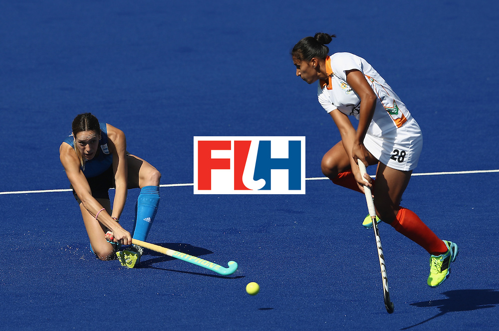 RIO DE JANEIRO, BRAZIL - AUGUST 13:  Victoria Zuloaga of Argentina fires a shot past Rani during the Women's pool B hockey match between Argentina and India on Day 8 of the Rio 2016 Olympic Games at the Olympic Hockey Centre on August 13, 2016 in Rio de Janeiro, Brazil.  (Photo by David Rogers/Getty Images)