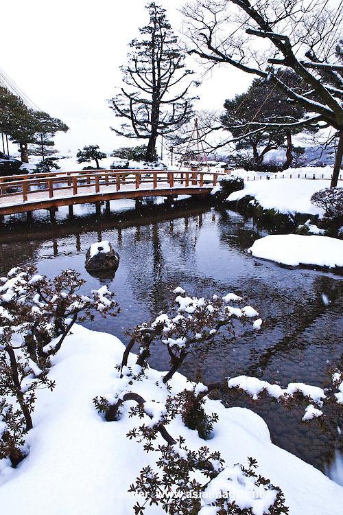 "Yukimibashi Bridge at Kenrokuen, the ""Six Attributes Garden"" (spaciousness, seclusion, artifice, antiquity, watercourses and panoramas) is one of the Three Great Gardens of Japan along with Kairakuen and Korakuen."