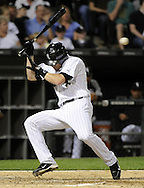 CHICAGO - JUNE 06:  Gordon Beckham #15 of the Chicago White Sox ducks out of the way just in time to avoid being hit by a pitch thrown by Michael Pineda #36 of the Seattle Mariners in the seventh inning on June 6, 2011 at U.S. Cellular Field in Chicago, Illinois.  The White Sox defeated the Mariners 3-1.  (Photo by Ron Vesely)  Subject:  Gordon Beckham