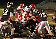 Iowa City High's Jake Leohr (18) is stopped at the 1 yard line by the Linn-Mar defense on a fourth and goal play during during the game between the Iowa City High Little Hawks and the Linn-Mar Lions at Linn-Mar Stadium in Marion on Friday October 12, 2012.