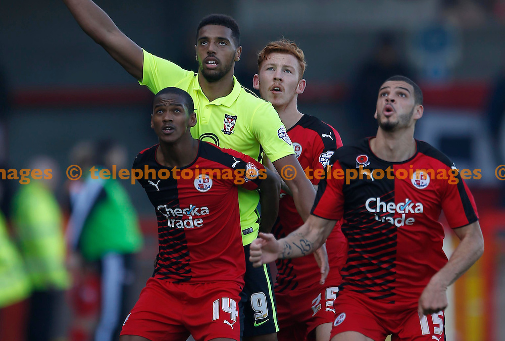 Crawley&rsquo;s Lewis Young, Josh Yorwerth  and Shamir Fenelon mark Vadaine Oliver of York during the Sky Bet League 2 match between Crawley Town and York City at the Checkatrade.com Stadium in Crawley. October 31, 2015.<br /> James Boardman / Telephoto Images<br /> +44 7967 642437