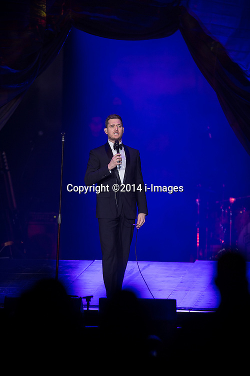 Michael Buble live. Saturday, 1st March 2014. Manchester , UK . Michael Buble performs at the Phones 4 U Arena in Manchester . Picture by i-Images