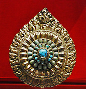 Reliquary with lotus ornament set amid flames in gilt, copper and turquoises. Tibet, 1700-1900