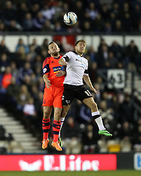 Derby County's Jamie Ward jumps with Boltons Jay Spearing - Photo mandatory by-line: Matt Bunn/JMP - Tel: Mobile: 07966 386802 16/02/2014 - SPORT - FOOTBALL - IPro Stadium - Pride Park - Derby - Derby County v Bolton - Sky Bet Championship
