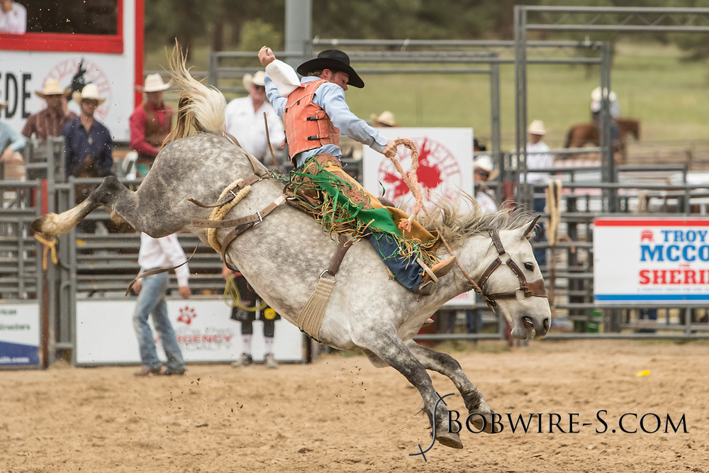 Saddle brond rider Wyatt Hageman rides Summit Pro Rodeo's Party Code during the third performance of the Elizabeth Stampede on Sunday, June 3, 2018.