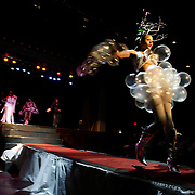 TP_301484_ALLE_Hair_05.WILLIE J. ALLEN JR. | Times.(Tampa).Shavon Woodson, 21 (cq) struts down the walkway during the Platinum Plus Hair Studio Hair and Barber battle at the Historic Ritz Theater on Sunday evening.   Woodson sporting balloons with wooden branches in her hair was part of the Hair by Michelle Allen salon team.  The winners of the competition were awarded $5,000 worth of cash and prizes.