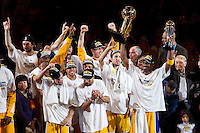 17 June 2010:  Guard Kobe Bryant of Los Angeles Lakers holds up the Larry O'Brien NBA Championship Trophy and the Bill Russell Finals MVP Trophy as teammates celebrate after the Lakers defeat the Boston Celtics 83-79 and win the NBA championship in Game 7 of the NBA Finals at the STAPLES Center in Los Angeles, CA.