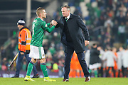 Northern Ireland manager Michael O'Neill and Northern Ireland midfielder Steven Davis (8) shake hands following the UEFA European 2020 Qualifier match between Northern Ireland and Netherlands at National Football Stadium, Windsor Park, Northern Ireland on 16 November 2019.