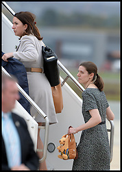 The Duchess of Cambridge PA Rebecca Deacon (left) and Prince George's nanny aria Teresa Turrion Borrallo leaves with The Duke and Duchess of Cambridge with their son Prince George leave Canberra airport, Australia, as they head back to the UK on the final day of their 19 day tour of New Zealand and Australia, Friday, 25th April 2014. Picture by Andrew Parsons / i-Images