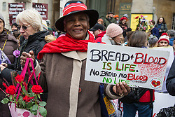 London, UK. 19th January, 2019. Gloria Wildman joins thousands of women taking part in the Global Women's March from BBC Broadcasting House to Trafalgar Square to attend a Bread & Roses Rally Against Austerity organised by Women's March London. Inspired by the 1912 Bread & Roses protests which revolutionised workers' rights for women and in the light of Brexit, the organisers called for assurances from the Government in ending policies of austerity which lead to economic oppression, violence against women, the gender pay gap, racism, fascism, institutional sexual harassment and the hostile environment experienced by marginalised groups.