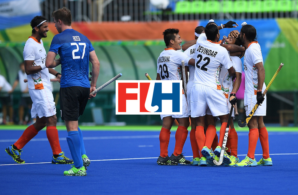 India's Kothajit Khadangbam (2R) celebrates with teammates after scoring a goal during the men's field hockey Argentina vs India match of the Rio 2016 Olympics Games at the Olympic Hockey Centre in Rio de Janeiro on August, 9 2016. / AFP / MANAN VATSYAYANA        (Photo credit should read MANAN VATSYAYANA/AFP/Getty Images)