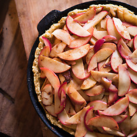 Stove top Organic Apple pie in a cast iron skillet with a gluten free crust.