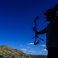 Dave Miller gets ready to shoot at a target on Thursday at the Galllup Bow Clup in Gallup. Miller has been recreationally playing with bows for the past 30 year.