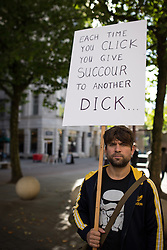 © Licensed to London News Pictures . 06/10/2013 . Manchester , UK . A man carries a placard . A demonstration against the Daily Mail newspaper in central Manchester's St Anne's Square today (6th October 2013) . Photo credit : Joel Goodman/LNP