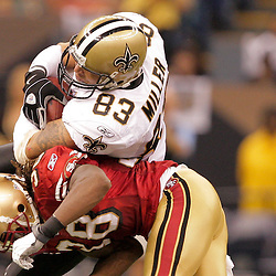 2008 September 28: San Francisco 49ers defensive back Dashon Goldson (38) hit New Orleans Saints tight end Billy Miller (83) after making a catch during the NFL week four game between the San Francisco 49ers and the New Orleans Saints at the Louisiana Superdome in New Orleans, LA.