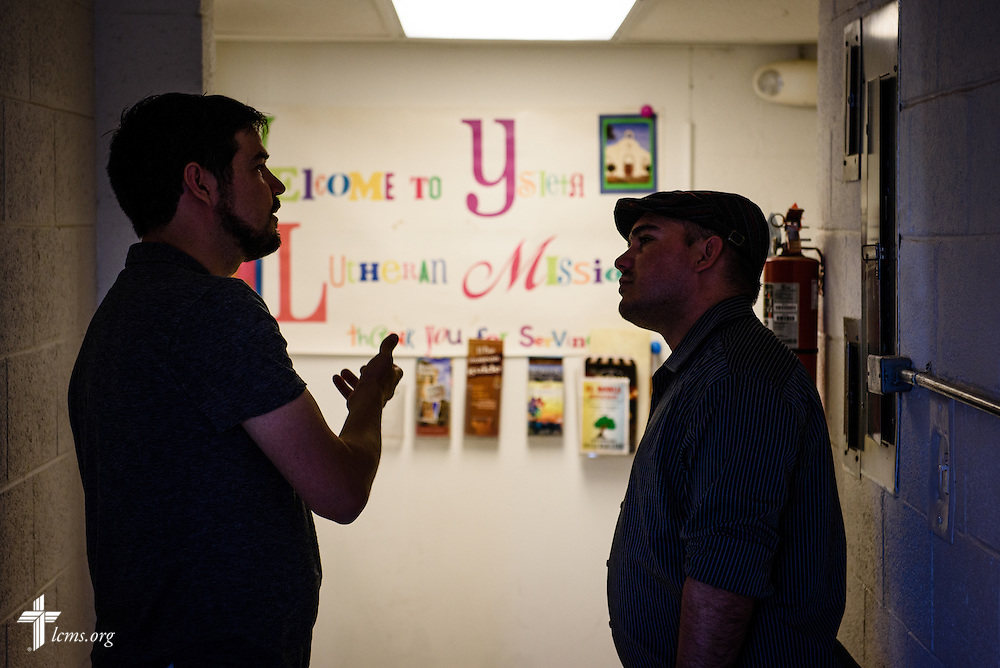The Rev. Stephen Heimer, pastor of nearby Zion Lutheran Church and chief operating officer of Ysleta Lutheran Mission Human Care, chats with Ahmed Cespedes, a new Cuban immigrant to the United States, at YLM on Friday, May 20, 2016, in El Paso, Texas. LCMS Communications/Erik M. Lunsford