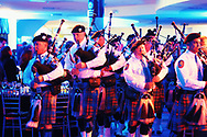 Garden City, New York, U.S. November 14, 2019. The Nassau County Police Emerald Society Pipe Band performs during the 17th Annual Cradle of Aviation Museum Air and Space Gala. The event helps support the development of new activities and educational programs, and honors the innovations of leaders in aviation, technical achievement, and leadership.